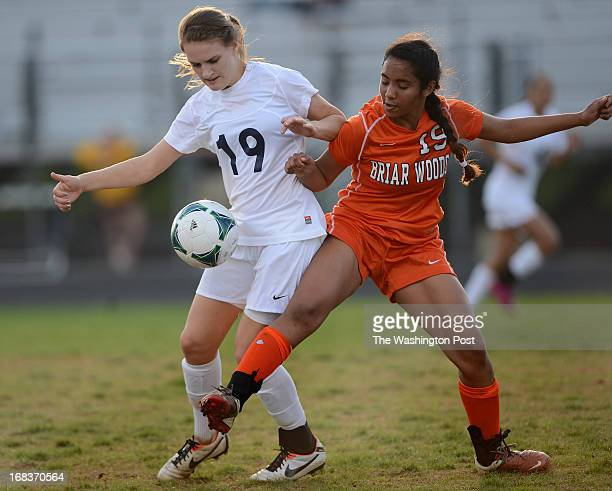 Stone Bridge's Ashley Herndon left and Briar Woods' Mia Venkat right battle for the ball during the game at Stone Bridge High School on Wednesday...