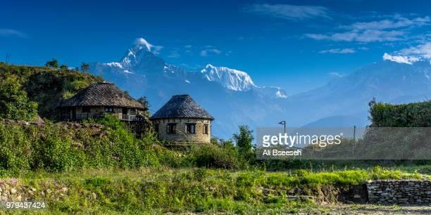 stone building and himalayas in background, pokhara, kaski, nepal - pokhara stock pictures, royalty-free photos & images