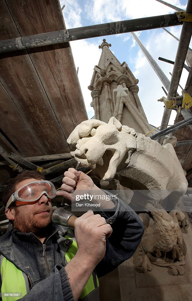 Stone carver Simon Smith puts finishing touches to a gargoyle on Westminster Abbey's Chapter House on April 14, 2010 in London, England. Built in the 1250's Chapter House is one of London's oldest buildings, but over the years has suffered deterioration to much of its stone facade because of prevailing weather conditions. With the help of a team of stonemasons, led by English Heritage, the exterior has now been carefully returned to it's former glory with a full complement of newly carved friezes, gargoyles and fully restored stained glass windows.