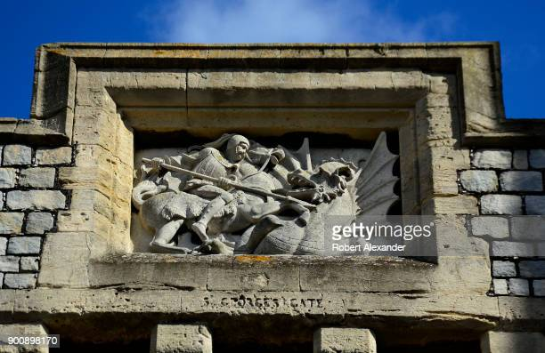 A stone carving depicting Saint George slaying a dragon embellishes St Georges Gate at Windsor Castle in Windsor England Windsor Castle is a...