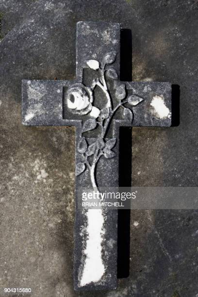 Stone Carving, image of a religious cross set in a Cemetery