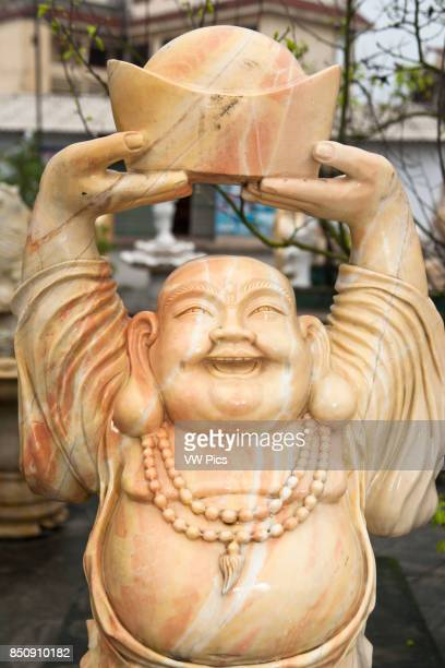 Stone carving of a happy smiling Buddha Hai Duong Vietnam