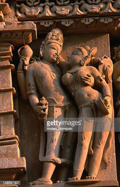 stone carving of vishnu and laxmi posing at parsvanath temple. - goddess lakshmi stock photos and pictures