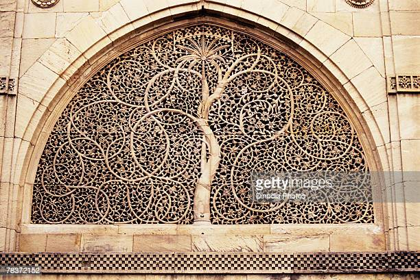 Stone carving rendering of tree of life