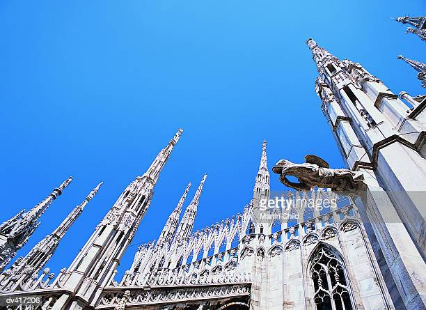 Stone Carvings and a Gargoyle on the Roof of the Duomo, Milan, Italy