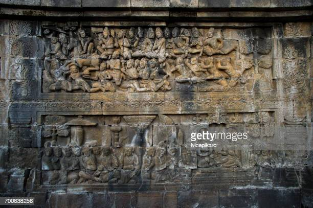 stone carvings at borobudur temple. - circa 9th century stock pictures, royalty-free photos & images