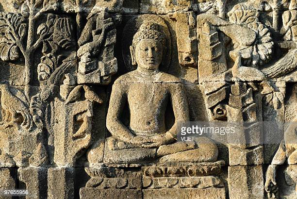 stone carvings of borobudur temple in indonesia - yogyakarta stock pictures, royalty-free photos & images