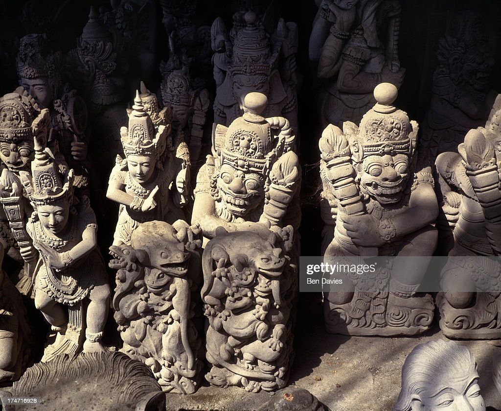 Stone carvings of gods and demons for sale in the town of