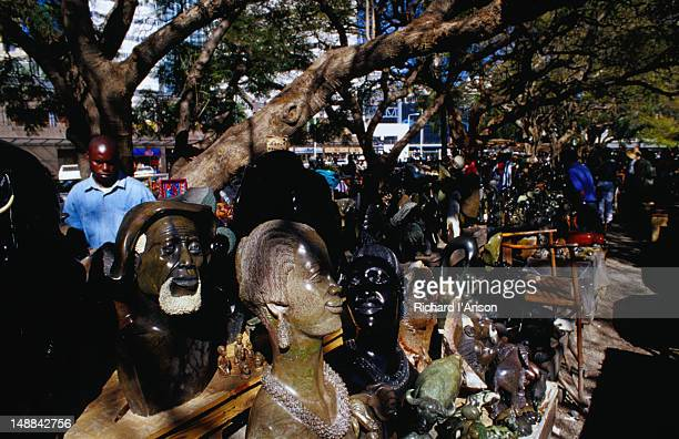 Stone carvings; souvenir stalls on African Unity Square