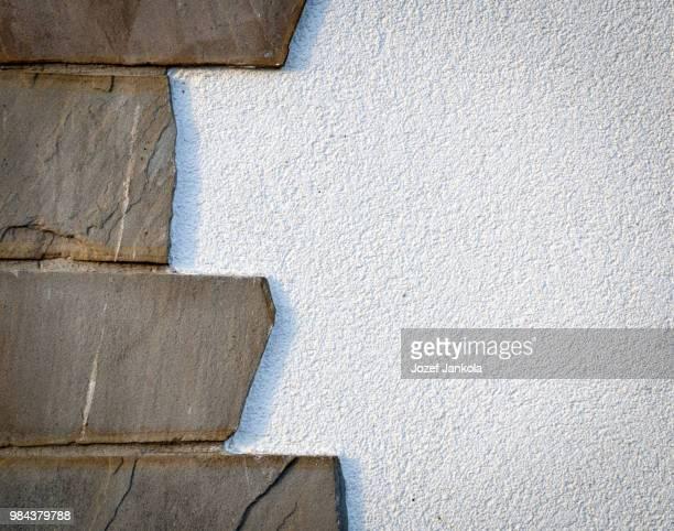stone cladding on white wall
