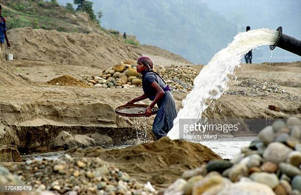 A stone collector at work on the bank of Mari River in Jaflong Bangladesh The river coming from the Himalayas of India brings million tons of stone...