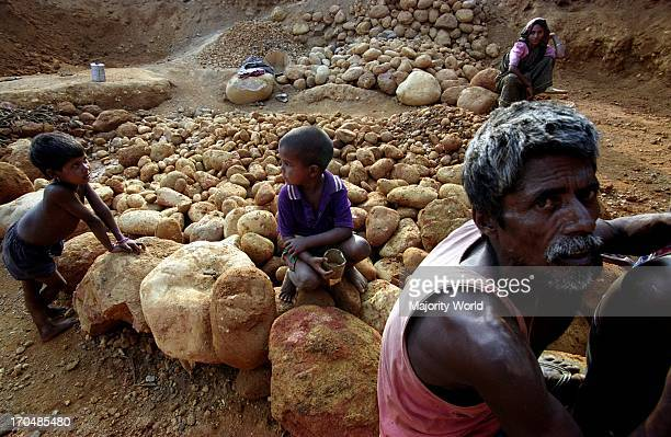 A stone collector on the bank of Mari River in Jaflong Bangladesh The river coming from the Himalayas of India brings million tons of stone boulders...