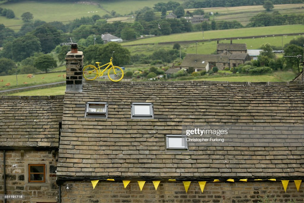 A stone cottage adorns it's roof with a yellow bicycle on route two as Yorkshire prepares to host the Tour de France Grand Depart, on June 24, 2014 in Hebden Bridge, United Kingdom. The people of Yorkshire are preparing to give the riders of the 2014 Tour de France a grand welcome as the route of stages one and two are decorated with bunting, bikes and yellow jerseys The Grand Depart of the 2014 Tour De France is taking place in Leeds with the first two stages taking place across Yorkshire on 6th and 7th of July.