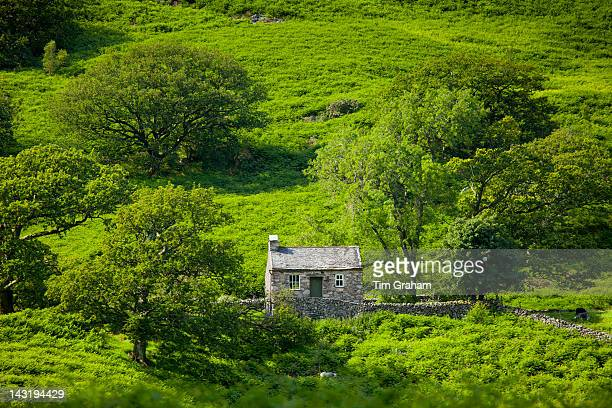 Stone cottage in Hard Knott Pass near Eskdale in the Lake District National Park Cumbria UK