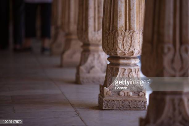 Stone craved pillars in The City Palace of Udaipur