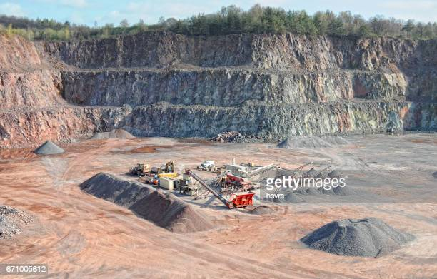 stone crusher in a quarry. mining industry. repairing service on excavator.