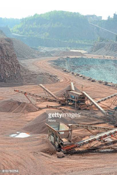 stone crusher in an open pit mine of porphyry rocks.