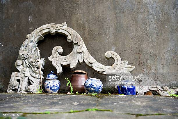 Stone Dragon Carving and Chinese Vase at Thai
