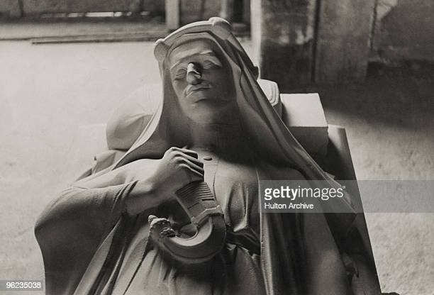 Stone effigy, by war artist Eric Kennington, of British soldier, adventurer and author T. E. Lawrence in the church of St Martin, Wareham, Dorset,...