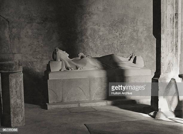 A stone effigy by war artist Eric Kennington of British soldier adventurer and author T E Lawrence in the church of St Martin Wareham Dorset circa...