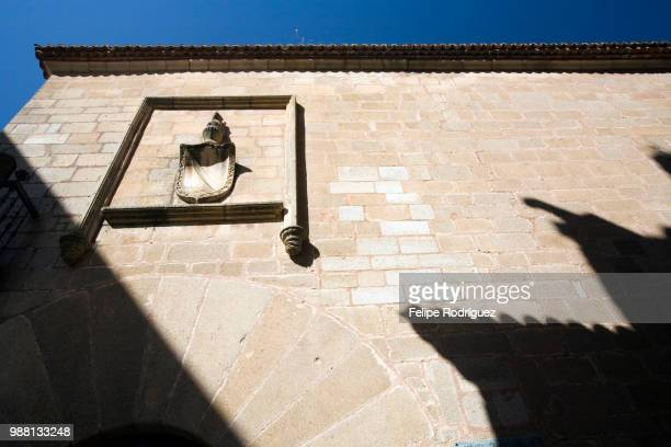 stone facade and coat of arms of carvajal palace, caceres, spain - carvajal stock photos and pictures