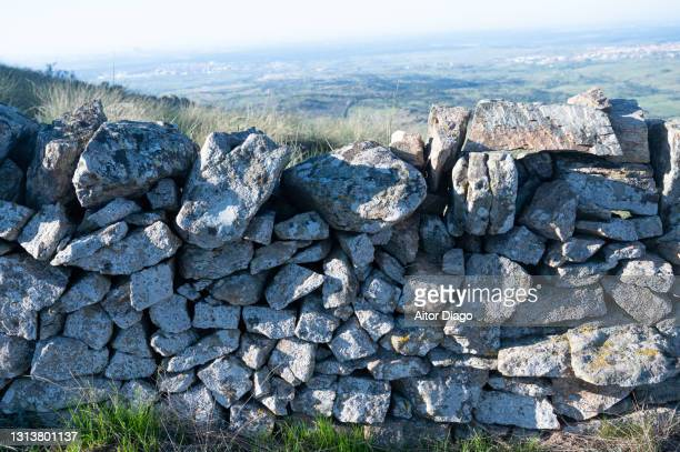 stone fence in the in the countryside. spain - pueblo built structure stock pictures, royalty-free photos & images