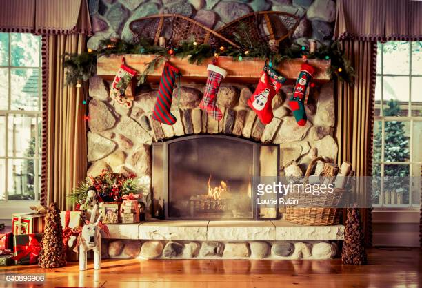 stone fireplace decorated for christmas - christmas stocking stock pictures, royalty-free photos & images