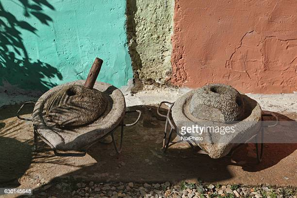Stone hand presses used for making argan oil outside the argan oil cooperative in Morocco Africa on 17 December 2016 Argan oil is used both for food...