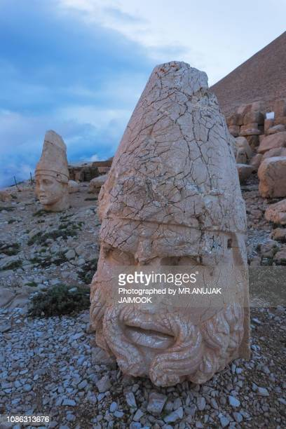 stone head statues at nemrut mountain in turkey - hermes stock pictures, royalty-free photos & images