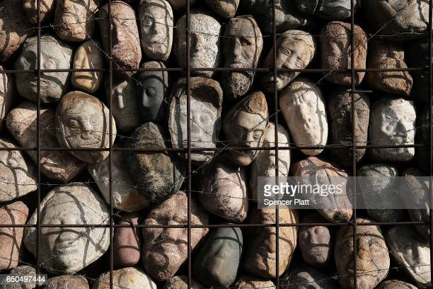 Stone heads are displayed in a Moscow park as part of a memorial to the victims of totalitarianism on March 9 2017 in Moscow Russia Millions of...
