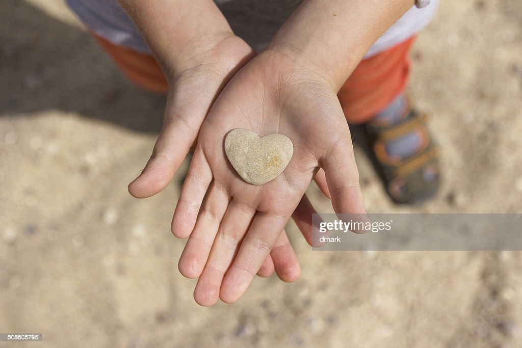 Stone heart in hands : Stock Photo