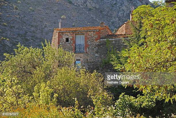 Stone house in the picturesque village of Castelnou located in the foothills of Aspres at the foot of Canigou Pyrenees Orientales France