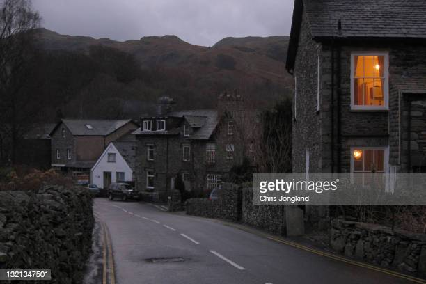 stone houses on quiet residential street in the mountains - rain stock pictures, royalty-free photos & images