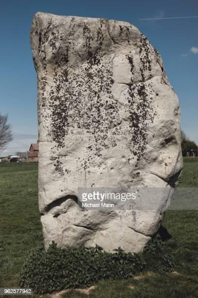 Stone in field against sky, Avebury, Wiltshire, United Kingdom
