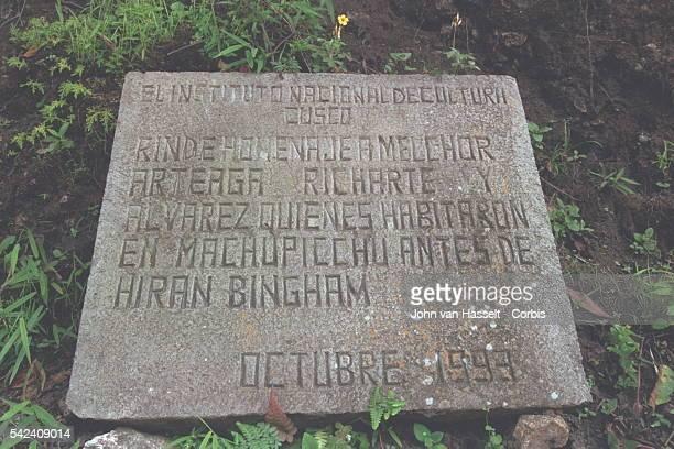 Stone in tribute to the two peasants who were living at Machu Picchu when American academic, explorer, treasure hunter and politician Hiram Bingham...