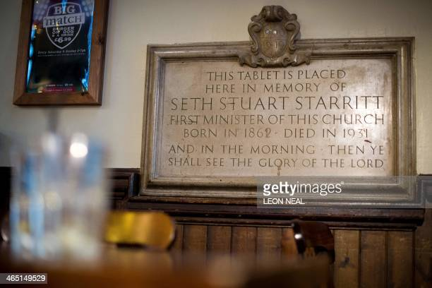 A stone laid to mark the death of the first minister of the church is pictured inside O'Neills pub built in a former Presbyterian church in Muswell...