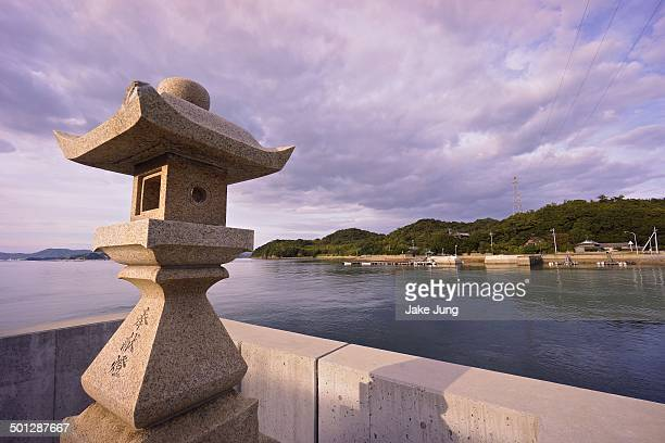 Stone lantern overlooking bay on Naoshima Island