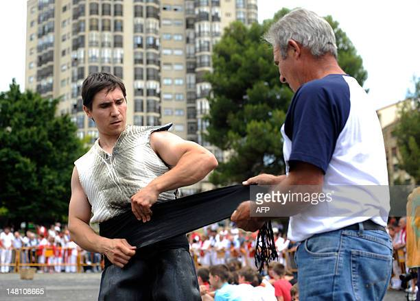Stone lifter Josetxo Urrutia prepares to lift a stone during a rural Basque sports championship during the San Fermin Festival on July 9 in the...