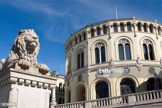 stone lion and stortinget - traditionally norwegian stock pictures, royalty-free photos & images