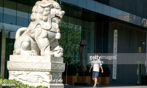 Stone lion guards in front of China Banking Regulatory Commission China Banking Regulatory Commission Confirmed by Organization Department of the CPC...