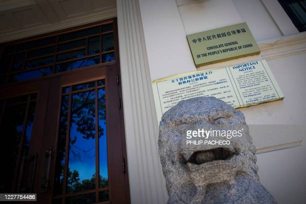 Stone lion stands outside the Consulate General of the People's Republic of China in San Francisco, California on July 23, 2020. - The US Justice...