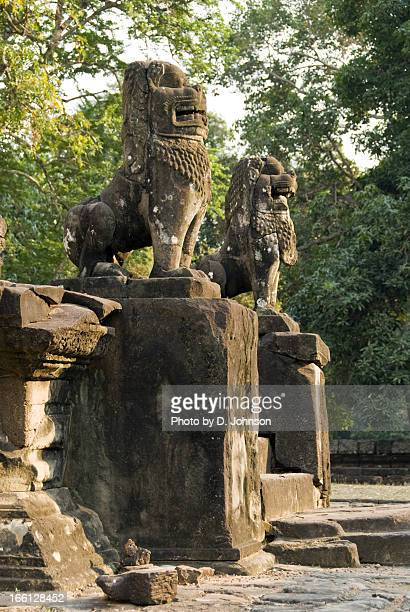 stone lions, bakong temple, angkor - king of cambodia stock photos and pictures