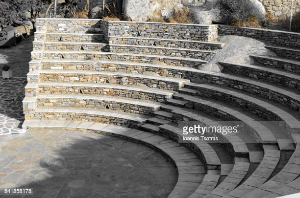 stone made theatre in tinos island (greece) - amphitheatre stock photos and pictures