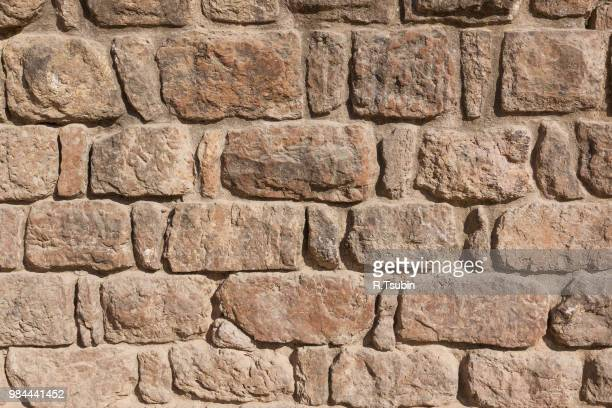 stone made wall texture background wallpapper - sandstone stock photos and pictures