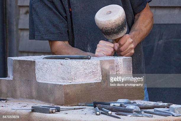 Stone mason at work detail
