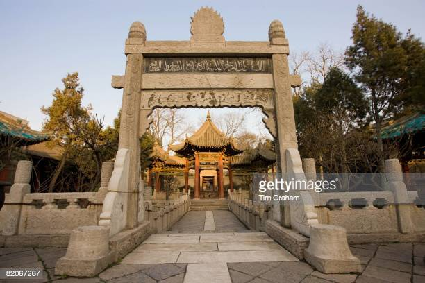 Stone Memorial Gateway leading to the Phoenix Pavilion at the Great Mosque in the Muslim area of Xian China