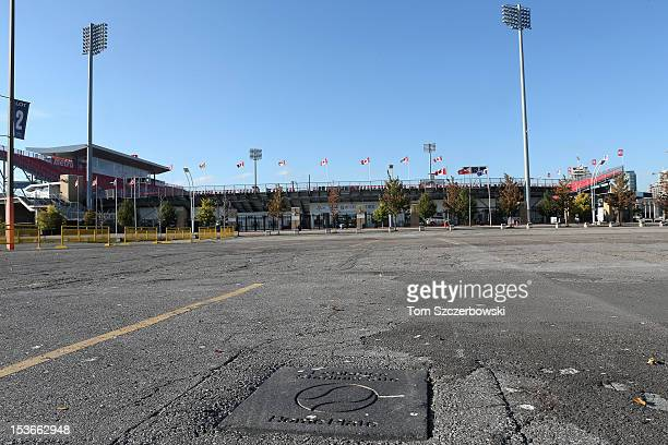 A stone monument on a parking lot marks the spot of home plate at Exhibition Stadium the former home stadium of the Toronto Blue Jays with BMO field...