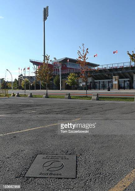 A stone monument on a parking lot marks the spot of second base at Exhibition Stadium the former home stadium of the Toronto Blue Jays with BMO Field...
