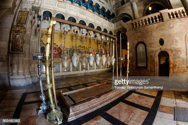 stone of anointing of jesus in the church of the holy sepulchre - stations of the cross stock pictures, royalty-free photos & images