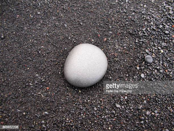 A stone on the beach of Reynisfjara, near Vik, south coast of Iceland